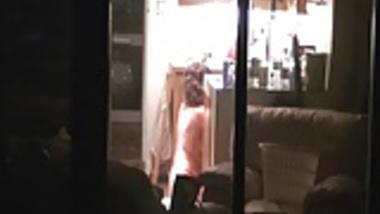 Neighbour in her kitchen