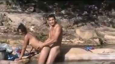 Outdoor village sex in river captured by voyeur