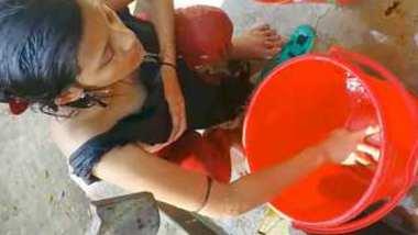 Desi Hot village girl bathing outside