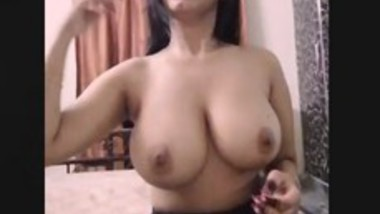 Beautiful girl showing her melons while listening hindi sensual song