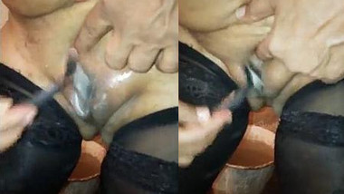 Pretty Desi woman in XXX stockings shaves pussy in front of husband