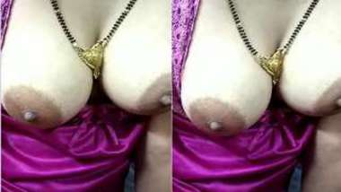 Indian female comes out with her XXX jugs hidden under a purple dress